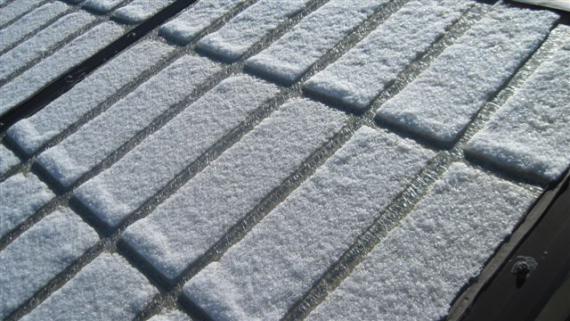 Snow is melted because the skylight panel is not thermally broken and therefore conducts heat/cold through the panel.