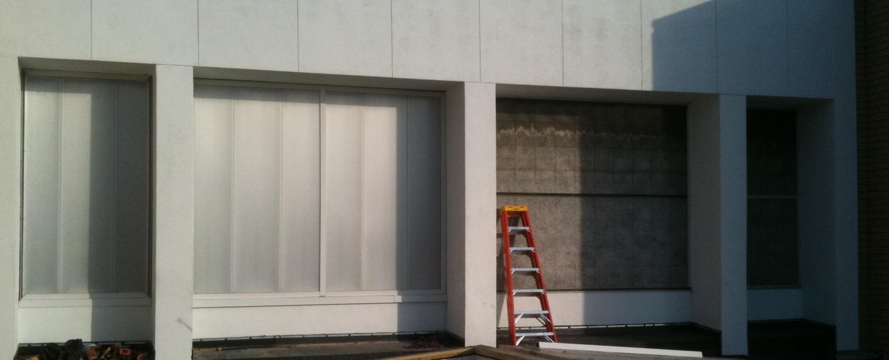 Exterior view of failed fiberglass wall lights